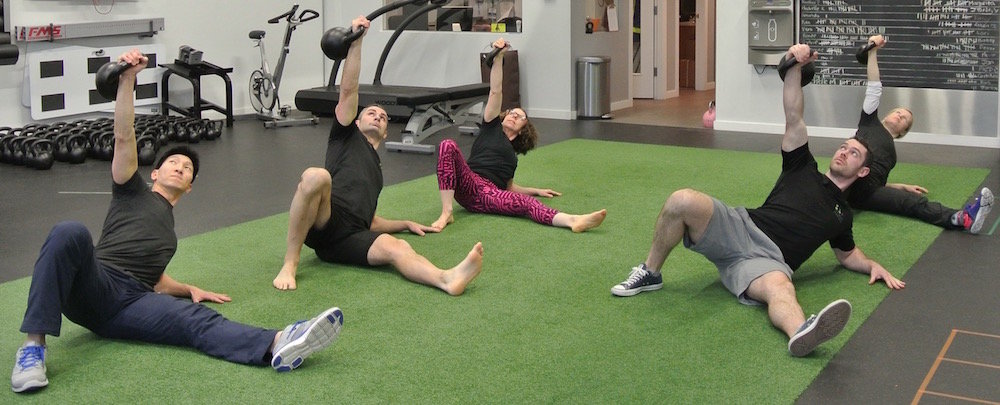 The it's time! Fitness Results team doing Turkish Get Ups